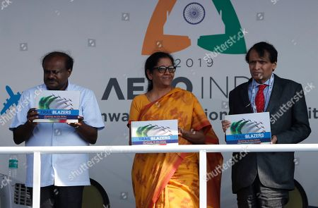 Nirmala Sitharaman, Suresh Prabhu, H. D. Kumaraswamy. Indian Defense Minister Nirmala Sitharaman, center, Civil Aviation Minister Suresh Prabhu, right, and Karnataka state Chief Minister H. D. Kumaraswamy release a coffee table book during the inaugural ceremony of Aero India 2019 at Yelahanka air base in Bangalore, India, . Aero India is a biennial event with flying demonstrations by stunt teams and militaries and commercial pavilions where aviation companies display their products and technology