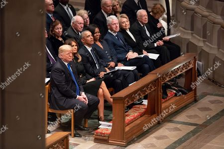 Four living US Presidents seated in the same pew at the funeral service for former President George H.W. Bush. Former President George W. Bush and his wife Laura sat separately, with the Bush family, at the Washington National Cathedral, Dec. 5, 2018. In the second row are the former US Vice Presidents
