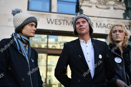 Lauri Love stands outside Westminster Magistrates court with his partner (left). Mr Love, who previously won an extradition case to face hacking charges in US, recently launched a civil case to recover materials seized by National Crime Agency (NCA) agents at point of arrest over 5 years ago. Today the Judge ruled in favour of the NCA on the basis that the encrypted data on the two computers and drives was not his property. Mr Love sought clarification as to how this assessment had been arrived at, but none was forthcoming.