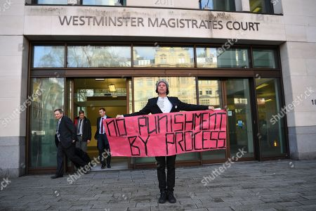 Lauri Love stands outside Westminster Magistrates court as members of National Crime Agency (NCA) legal team exit behind him (Mr Bird, lead NCA counsel far left). Mr Love, who previously won an extradition case to face hacking charges in US, recently launched a civil case to recover materials seized by NCA agents at point of arrest over 5 years ago. Today the Judge ruled in favour of the NCA on the basis that the encrypted data on the two computers and drives was not his property. Mr Love sought clarification as to how this assessment had been arrived at, but none was forthcoming.