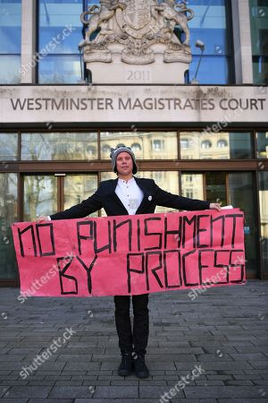 Lauri Love stands outside Westminster Magistrates court with a banner reading 'No Punishment by Process'. Mr Love, who previously won an extradition case to face hacking charges in US, recently launched a civil case to recover materials seized by NCA agents at point of arrest over 5 years ago. Today the Judge ruled in favour of the NCA on the basis that the encrypted data on the two computers and drives was not his property. Mr Love sought clarification as to how this assessment had been arrived at, but none was forthcoming.