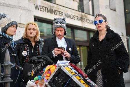 Lauri Love leaving Westminster Magistrates court with supporters. Mr Love, who previously won an extradition case to face hacking charges in US, recently launched a civil case to recover materials seized by National Crime Agency (NCA) agents at point of arrest over 5 years ago. Today the Judge ruled in favour of the NCA on the basis that the encrypted data on the two computers and drives was not his property. Mr Love sought clarification as to how this assessment had been arrived at, but none was forthcoming.