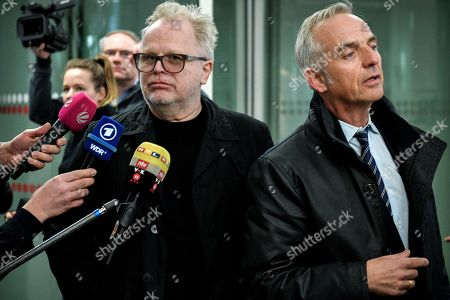 German musician Herbert Groenemeyer (L) and his attorney Daniel M. Krause (R) arrive at the Regional Court in Cologne, Germany, 20 February 2019. Two photographers are on trial after taking pictures and filming the singer and his family against his will and accusing Groenemeyer of an assault.
