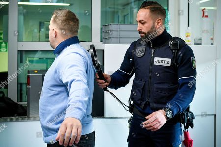 One of the defendants (L) arrives at the Regional Court in Cologne, Germany, 20 February 2019. Two photographers are on trial after taking pictures and filming German singer Herbert Groenemeyer and his family against his will in 2014, and accusing Groenemeyer of an assault.