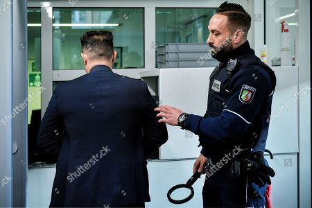 Stock Picture of One of the defendants (L) arrives at the Regional Court in Cologne, Germany, 20 February 2019. Two photographers are on trial after taking pictures and filming German singer Herbert Groenemeyer and his family against his will in 2014, and accusing Groenemeyer of an assault.