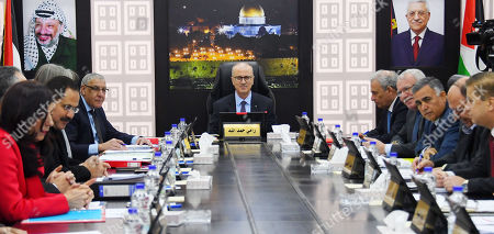 Palestinian Prime Minister Rami Hamdallah chairs a meeting of council ministery