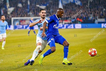 FC Schalke 04 defender Hamza Mendyl (3) is tackled by Manchester City midfielder Ilkay Gundogan (8) during the Champions League round of 16 leg 1 of 2 match between FC Schalke 04 and Manchester City at Veltins Arena, Gelsenkirchen