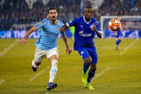 Manchester City midfielder Ilkay Gundogan (8) and FC Schalke 04 defender Hamza Mendyl (3) both go for the ball during the Champions League round of 16 leg 1 of 2 match between FC Schalke 04 and Manchester City at Veltins Arena, Gelsenkirchen