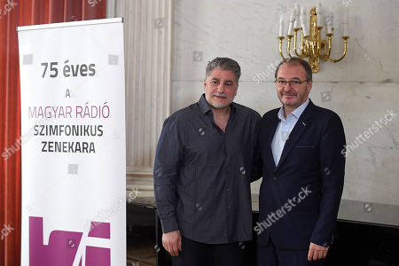 Stock Picture of Argentine opera singer and conductor Jose Cura (L) and Chief Executive of the Hungarian Radio Art Groups Geza Kovacs pose after a press conference introducing the tenor as first permanent guest artist of the art groups in the next three seasons at the Marble Hall of the Hungarian Radio in Budapest, Hungary, 20 February 2019. The inscriptions read: 'the Symphonic Orchestra of the Hungarian Radio is 75 years old'.