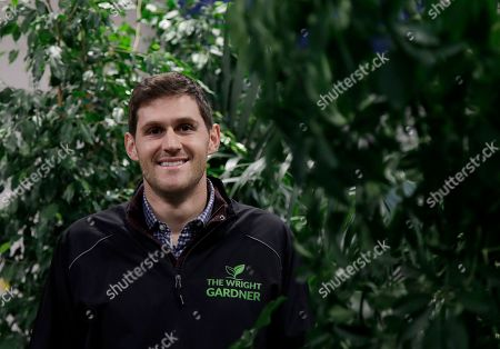 """Nick Haschka, owner of The Wright Gardner, poses for photos in South San Francisco, Calif. As Haschka bought four small horticultural businesses over the past two years, he had to help his new employees navigate almost constant change. """"They've had to get used to a new owner, new management style, and many new processes and tools,"""" says Haschka"""