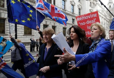 British politicians Joan Ryan, left, Heidi Allen, centre, and Anna Soubrey, right, arrive for a press conference in Westminster in London,. Cracks in Britain's political party system yawned wider Wednesday, as three pro-European lawmakers - Soubry, Allen and Wollaston - quit the governing Conservatives to join a newly formed centrist group of independents who are opposed to the government's plan for Britain's departure from the European Union