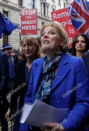 British politicians Joan Ryan, left, Anna Soubrey, centre, and Heidi Allen, right, arrive for a press conference in Westminster in London,. Cracks in Britain's political party system yawned wider Wednesday, as three pro-European lawmakers - Soubry, Allen and Wollaston - quit the governing Conservatives to join a newly formed centrist group of independents who are opposed to the government's plan for Britain's departure from the European Union