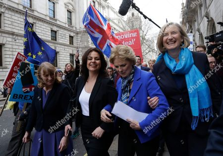 British politicians Joan Ryan, left, Heidi Allen, second left, Anna Soubrey, second right, and Sarah Wollaston, right, arrive for a press conference in Westminster in London,. Cracks in Britain's political party system yawned wider Wednesday, as three pro-European lawmakers - Soubry, Allen and Wollaston - quit the governing Conservatives to join a newly formed centrist group of independents who are opposed to the government's plan for Britain's departure from the European Union