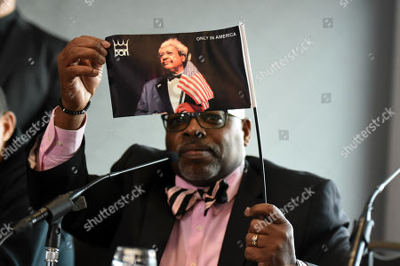 Carl Lewis holds a Don King flag during a Press Conference at Intercontinental at The O2 on 20th February 2019