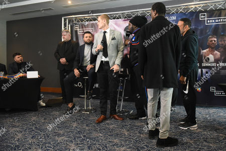 Bermane Stiverne exchanges words with Sam Jones (Joe Joyce's manager, R) during a Press Conference at Intercontinental at The O2 on 20th February 2019