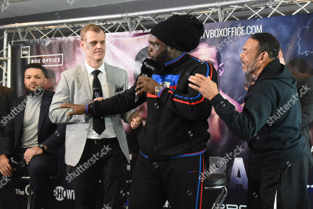 Bermane Stiverne is held back as he exchanges words with Sam Jones (Joe Joyce's manager, out of picture) during a Press Conference at Intercontinental at The O2 on 20th February 2019