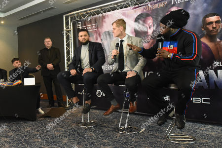 Bermane Stiverne exchanges words with Sam Jones (Joe Joyce's manager, L) during a Press Conference at Intercontinental at The O2 on 20th February 2019