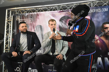 Bermane Stiverne exchanges words with Sam Jones (Joe Joyce's manager, out of picture) during a Press Conference at Intercontinental at The O2 on 20th February 2019