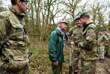 Prince Harry, Captain General Royal Marines, chats to 96 year old former World War 2 Marine Knocker White during his visit to 42 Commando Royal Marines at their base in Bickleigh to carry out a Green Beret presentation at Dartmoor National Park