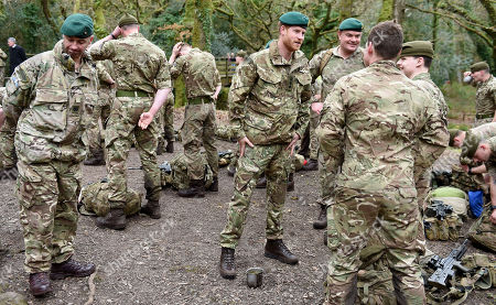 Stock Picture of Prince Harry, Duke of Sussex, Captain General Royal Marines, visits 42 Commando Royal Marines at their base in Bickleigh to carry out a Green Beret presentation at Dartmoor National Park on February 20, 2019 in Plymouth, England.