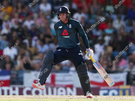 England's Jason Roy gestures after being hit in the hand by a delivery of West Indies' captain Jason Holder during the first One Day International cricket match at the Kensington Oval in Bridgetown, Barbados