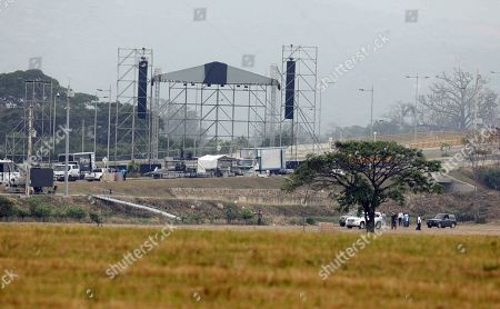 """Workers prepare the area for the upcoming """"Venezuela Aid Live"""" concert at the Tienditas International Bridge on the outskirts of Cucuta, Colombia, on the border with Venezuela, . Billionaire Richard Branson is organizing the concert on Feb. 22 featuring Spanish-French singer Manu Chao, Mexican band Mana, Spanish singer-songwriter Alejandro Sanz and Dominican artist Juan Luis Guerra, Colombian singers Juanes and Carlos Vives among others"""