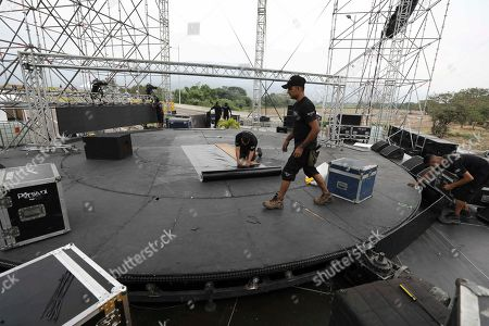 """Stock Photo of Workers prepare the stage for the upcoming """"Venezuela Aid Live"""" concert at the Tienditas International Bridge on the outskirts of Cucuta, Colombia, on the border with Venezuela, . Billionaire Richard Branson is organizing the concert on Feb. 22 featuring Spanish-French singer Manu Chao, Mexican band Mana, Spanish singer-songwriter Alejandro Sanz and Dominican artist Juan Luis Guerra, Colombian singers Juanes and Carlos Vives among others"""
