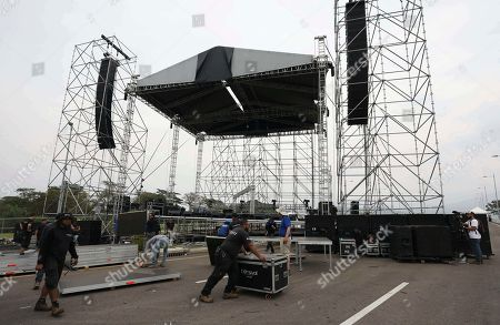 """Workers build the stage for the upcoming """"Venezuela Aid Live"""" concert at the Tienditas International Bridge on the outskirts of Cucuta, Colombia, on the border with Venezuela, . Billionaire Richard Branson is organizing the concert on Feb. 22 featuring Spanish-French singer Manu Chao, Mexican band Mana, Spanish singer-songwriter Alejandro Sanz and Dominican artist Juan Luis Guerra, Colombian singers Juanes and Carlos Vives and other more"""