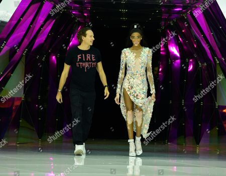 Stock Picture of Manuel Facchini and Winnie Harlow on the catwalk