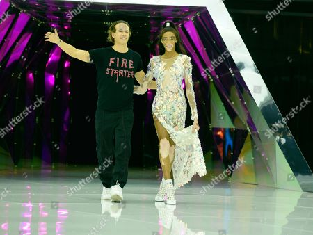 Stock Image of Manuel Facchini and Winnie Harlow on the catwalk