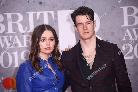 Aimee Lee Wood, Connor Swindells. Aimee Lee Wood and Connor Swindells pose for photographers upon arrival at the Brit Awards in London