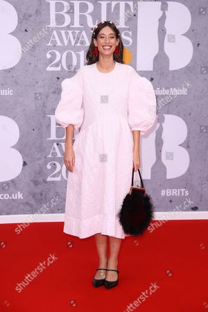 Laura Jackson poses for photographers upon arrival at the Brit Awards in London