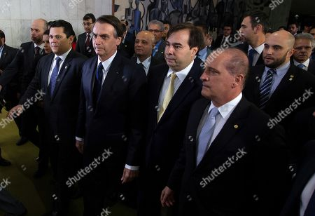The President of Brazil Jair Bolsonaro (2L), accompanied by the President of the Senate David Alcolumbre (L), the President of the Chamber of Deputies Rodrigo Maia (3L) and the Chief Minister of the Civil House Onix Lorenzone (R), participate in the delivery of the proposal to reform the pension and retirement system, in the building of the National Congress, in Brasilia, Brazil, 20 February 2019. Brazilian Presiden Jair Bolsonaro personally delivered to Parliament a proposal to reform the pension and retirement system, according to which the State will save about 265 billion US dollars in 10 years.