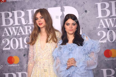 Stock Picture of Klara Soderberg, Johanna Soderberg. Singers Klara Soderberg, left, and Johanna Sderberg from the band 'First Aid Kit' pose for photographers upon arrival at the Brit Awards in London