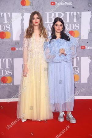 Klara Soderberg, Johanna Soderberg. Singers Klara Soderberg, left, and Johanna Sderberg from the band 'First Aid Kit' pose for photographers upon arrival at the Brit Awards in London