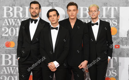 Members of British group The 1975 Ross MacDonald, Matthew Healy, George Daniel and Adam Hann arrive for the Brit Awards 2019 at the O2 Arena in Greenwich, London, Britain, 20 February 2019. It is the 39th edition of the British Phonographic Industry's annual pop music awards.