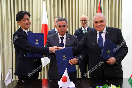 Palestinian Prime Minister Rami Hamdallah attends a signing ceremony with ambassador of Japan to Palestine, Takeshi kubo