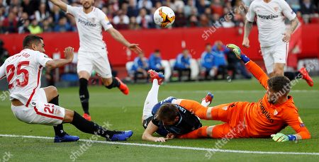 Sevilla's goalkeeper Tomas Vaclik (R) and defender Gabriel Mercado (L) in action against Lazio's midfielder Senad Lulic (C) during the UEFA Europe League round of 32 second leg match between Sevilla FC and SS Lazio at Ramon Sanchez Pizjuan stadium in Seville, Andalusia, Spain, 20 February 2019.