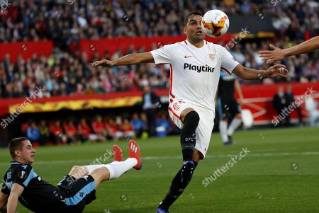 Sevilla's defender Gabriel Mercado (R) controls the ball during the UEFA Europe League round of 32 second leg match between Sevilla FC and SS Lazio at Ramon Sanchez Pizjuan stadium in Seville, Andalusia, Spain, 20 February 2019.