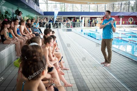 Stock Picture of Olympic champion Alain Bernard teaches the children of the Fontainebleau swimming club at the pool of Fontainebleau.