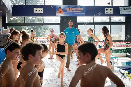 Stock Image of Olympic champion Alain Bernard teaches the children of the Fontainebleau swimming club at the pool of Fontainebleau.
