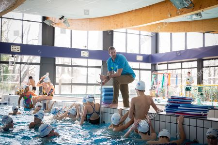 Olympic champion Alain Bernard teaches the children of the Fontainebleau swimming club at the pool of Fontainebleau.