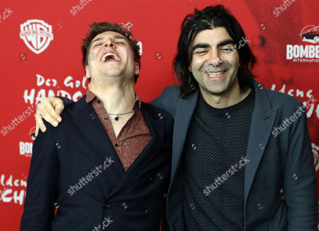 Jonas Dassler (L) and director Fatih Akin (R) pose on the red carpet during the premiere of the move 'The Golden Glove' (Der Goldene Handschuh) in Hamburg, northern Germany, 20 February 2019. The film tells the story of ripper Fritz Honka who lived in Hamburg.