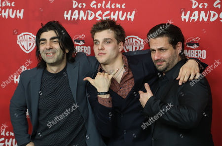 Fatih Akin and German actors Jonas Dassler and Adam Bousdoukos pose on the red carpet during the premiere of the move 'The Golden Glove' (Der Goldene Handschuh) in Hamburg, northern Germany, 20 February 2019. The film tells the story of ripper Fritz Honka who lived in Hamburg.
