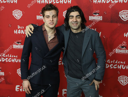 Stock Photo of Jonas Dassler (L) and director Fatih Akin (R) pose on the red carpet during the premiere of the move 'The Golden Glove' (Der Goldene Handschuh) in Hamburg, northern Germany, 20 February 2019. The film tells the story of ripper Fritz Honka who lived in Hamburg.