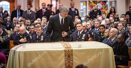NYC mayor Bill de Blasio passing the body of NYPD Detective Brian. P. Simonsen and a large turnout of police officers before sharing his kind words during the funeral service at Saint Rosalie Roman Catholic Church, Hampton Bays, New York, USA, 20 February 2019. Simonsen was killed in the line of duty on 12 February 2019.