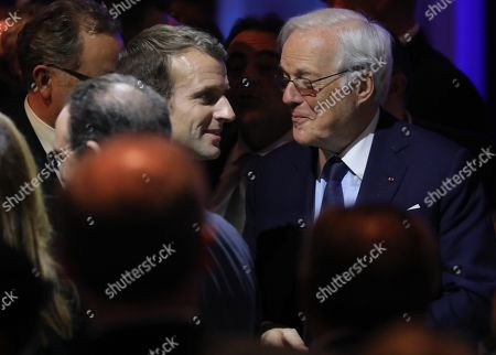 Stock Picture of French President Emmanuel Macron (L) speaks with French banker David de Rothschild during the 34th annual dinner of the Representative Council of Jewish Institutions of France (CRIF - Conseil Representatif des Institutions juives de France) in Paris, France, 20 February 2019.
