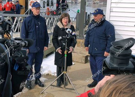U.S. Sen. Susan Collins, R-Maine, is flanked by Coast Guard Capt. Brian LeFebvre, left, and Rear Adm. Andrew Tiongson, right, as she addresses reporters after the ribbon-cutting at a U.S. Coast Guard regional command center, in South Portland, Maine. Collins said that she would vote for a congressional resolution disapproving of President Donald Trump's emergency declaration to build a wall on the southern border. She is the first Republican senator to publicly express support for such a resolution
