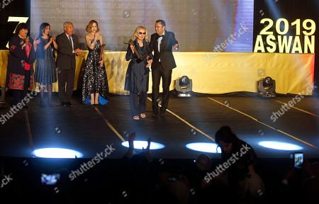 Barbara Bouchet, center, a German-American actress, is honored by Hassan Abou El-Ela director of Aswan International Women Film Festival (AIWFF), in Aswan, Egypt, late