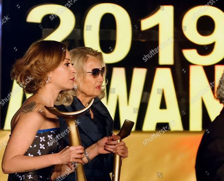 Barbara Bouchet, a German-American actress, right, is accompanied by Egyptian actresses Menna Shalaby as they were honored during the third edition of Aswan International Women Film Festival (AIWFF), in Aswan, Egypt, late